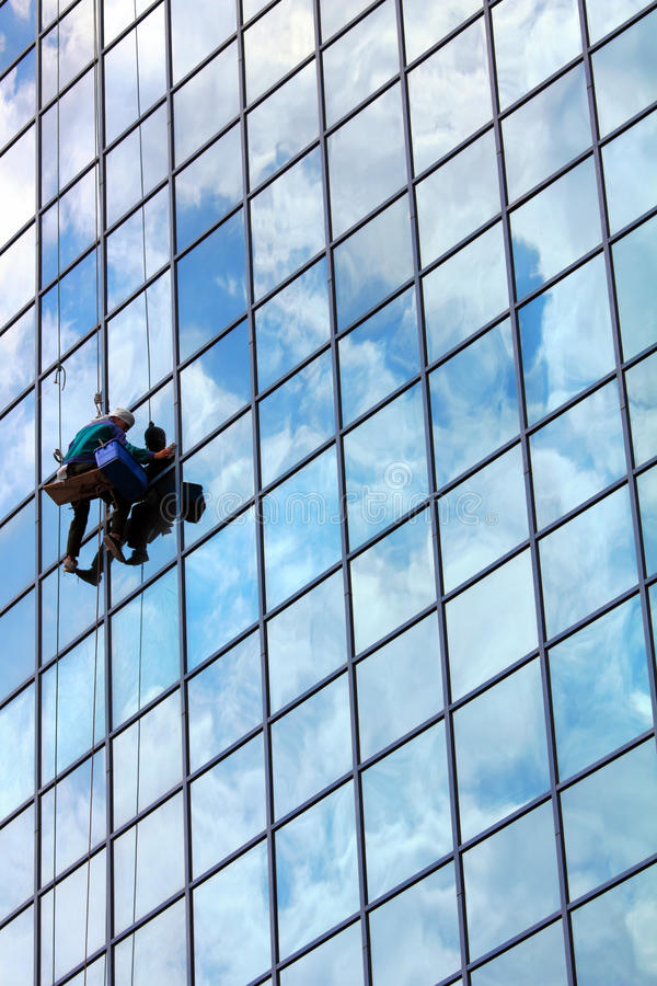 Window cleaner at work royalty free stock images