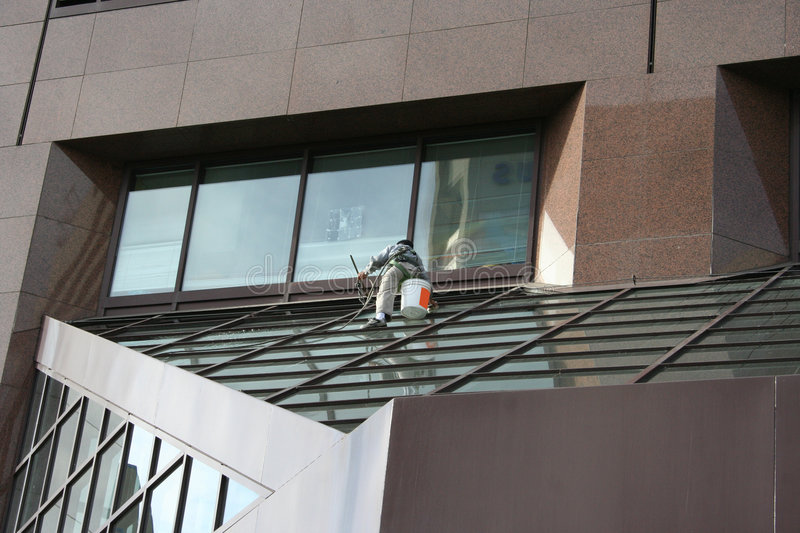 Window cleaner at work stock photos