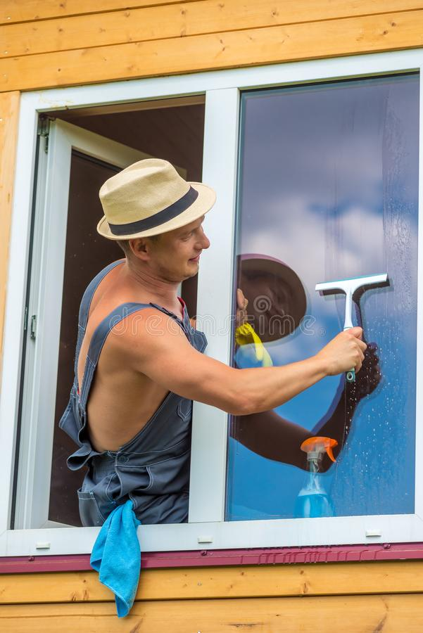 A window cleaner during work royalty free stock photo