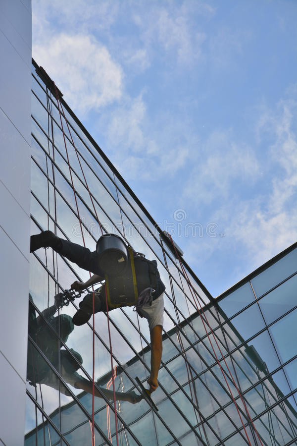Window cleaners on office building, photo taken 20.05.2014 royalty free stock photo