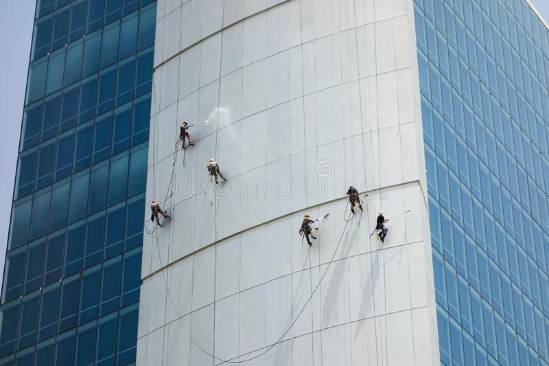 Window cleaners washing an office blocks exterior facade. In Qatar royalty free stock images