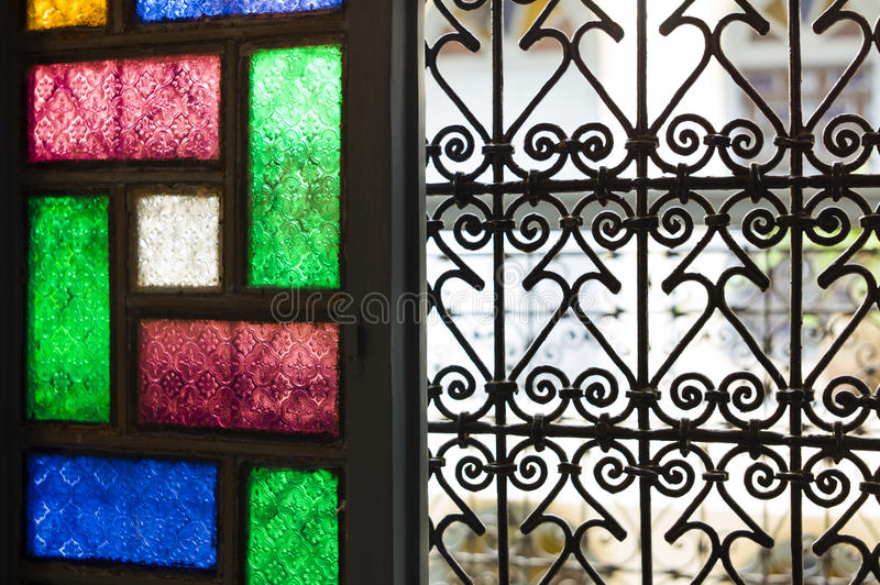 Window with colored glass and arabic grill in Marrakesh royalty free stock photography