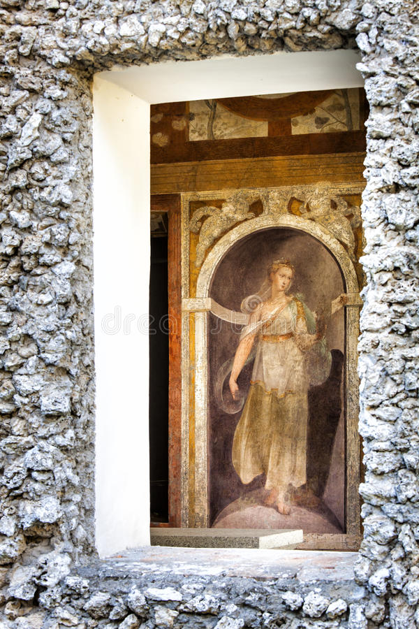 Window containing a fresco of the sixteenth century. A window containing a fresco of the sixteenth century. Walls of the building stones. Locatità: Villa royalty free stock image