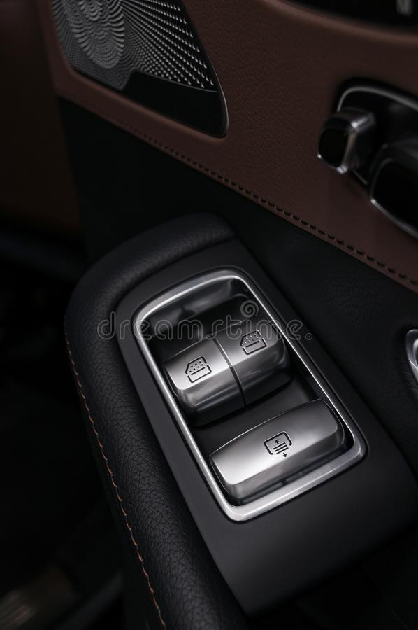 Window control buttons in business car. royalty free stock photography