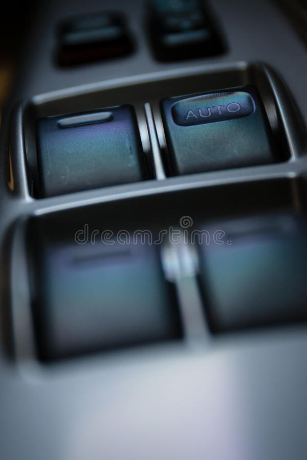Window control switch in a car stock photo