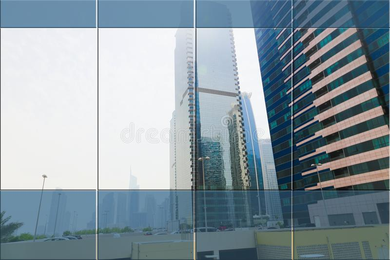 Offices. Window of corporate Office open on view of modern buildings skyscrapers royalty free stock images