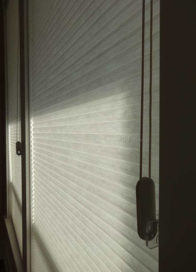 Window covering showing light and shades. Textured horizontal window coverings showing light and shades in a room royalty free stock images