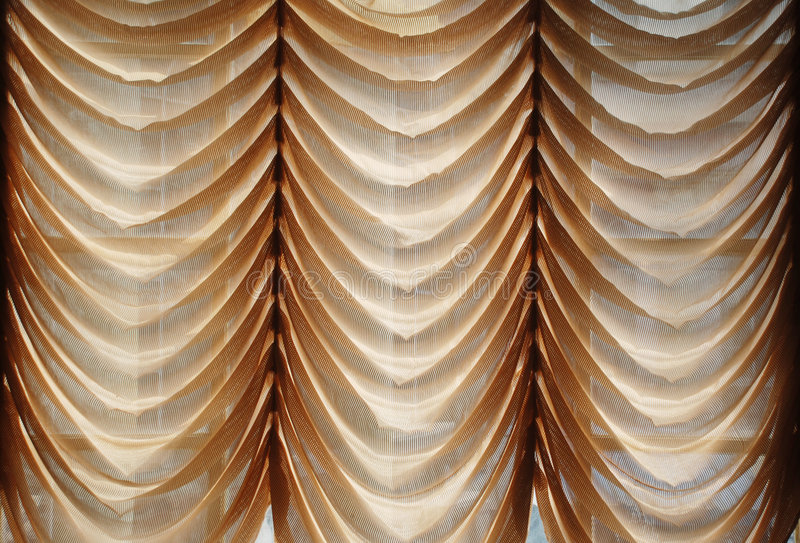 Window curtain. Voile window curtain with loose folds stock photography