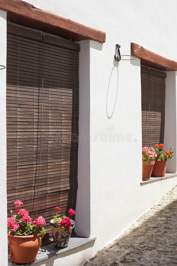 Window decorated with flower pots on the street Capileira Spain royalty free stock image