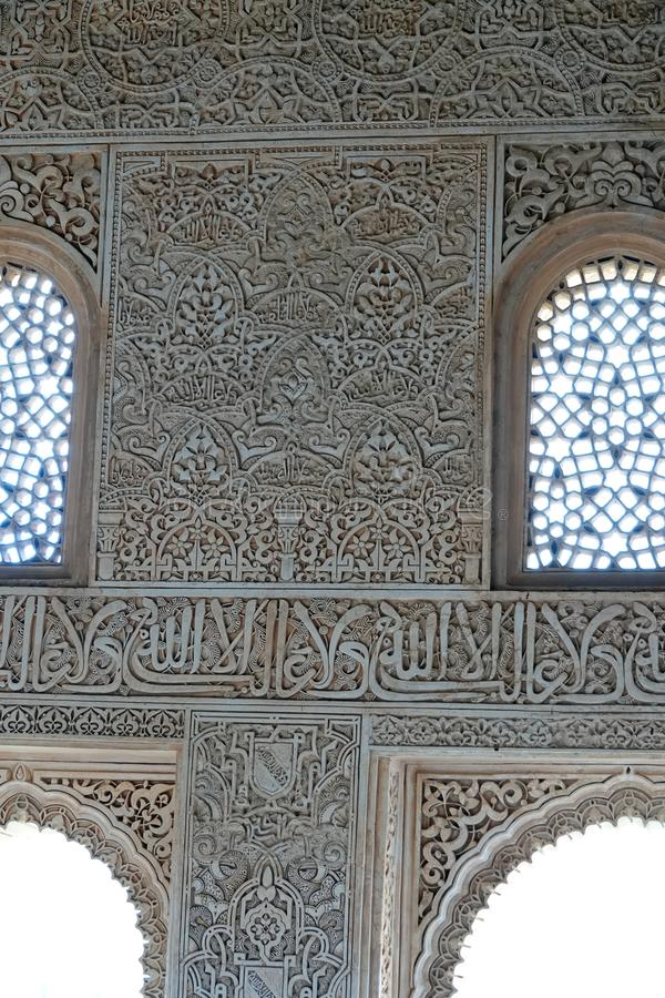 Nasrid palace window decorations at the Alhambra in Granada, Andalusia. Window details in the Palacio Arab at the Court of the Myrtles royalty free stock photos