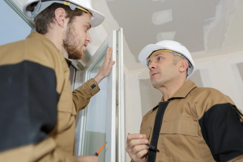 Window and door glazing installer. Double stock image