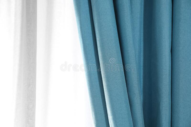 Window with elegant curtains indoors, closeup. View stock image