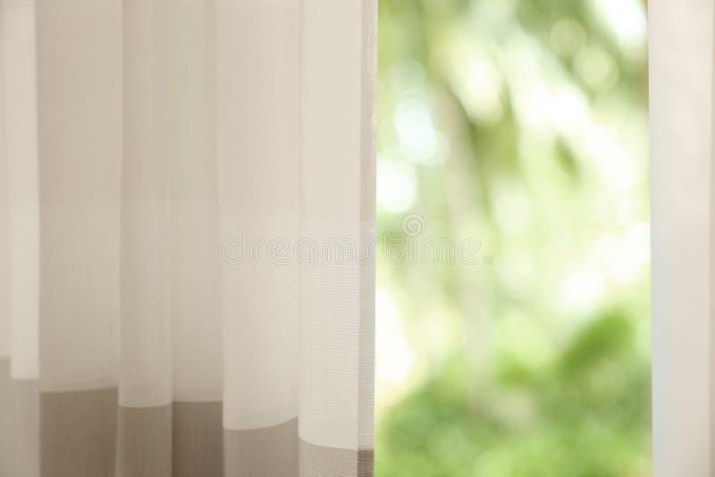 Window with elegant curtains indoors, closeup view. Window with elegant curtains indoors stock photography