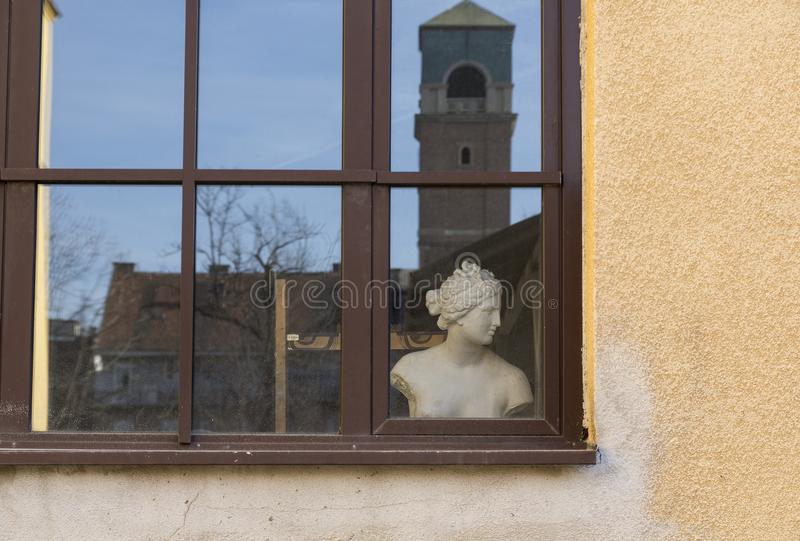 Window with female torso stock images