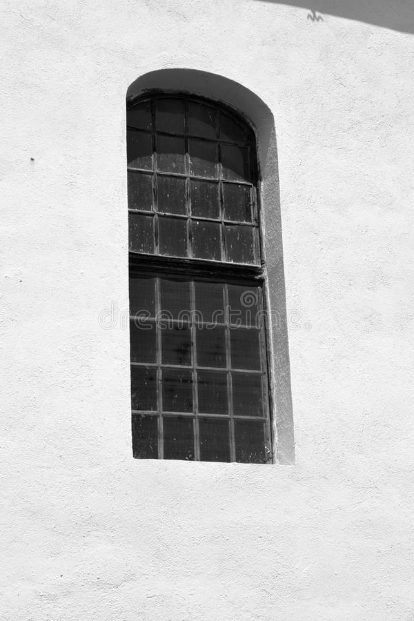 Window. Fortified medieval saxon church in Veseud, Zied, is a village in the commune Chirpăr from Sibiu County royalty free stock photo