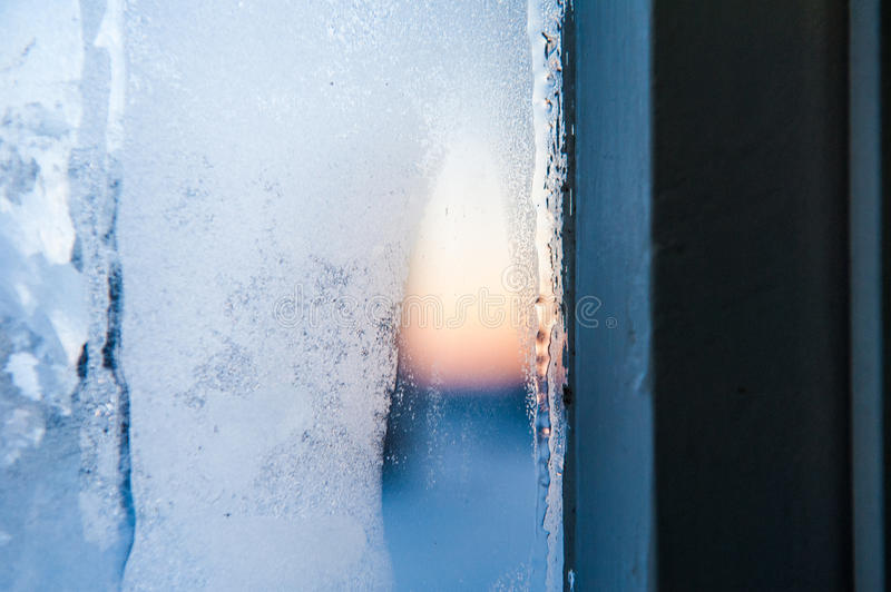 Window frame with Frost patterns on window. Festive bokeh backgroundwhite glass texture royalty free stock images