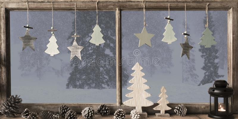 Window, Grey Winter Landscape, Christmas Tree. Window Frame With Grey Winter Landscape With Snow. View To Snowy Trees Outside With Snowflakes. Christmas Tree royalty free stock photos