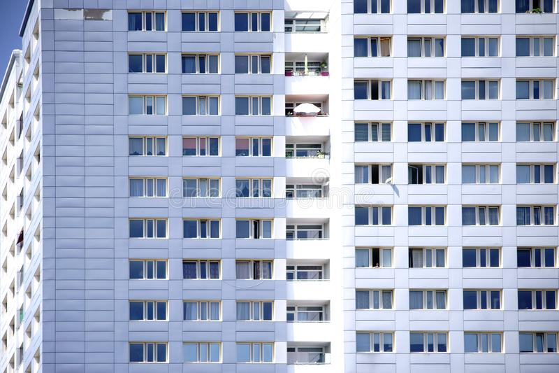 Window front skyscraper. The window front of a skyscraper with apartments and balconies royalty free stock image