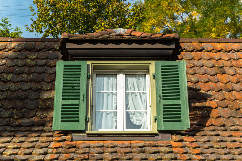 Window and garret roof. Jungfrau region, Canton Bern, Switzerland stock photo