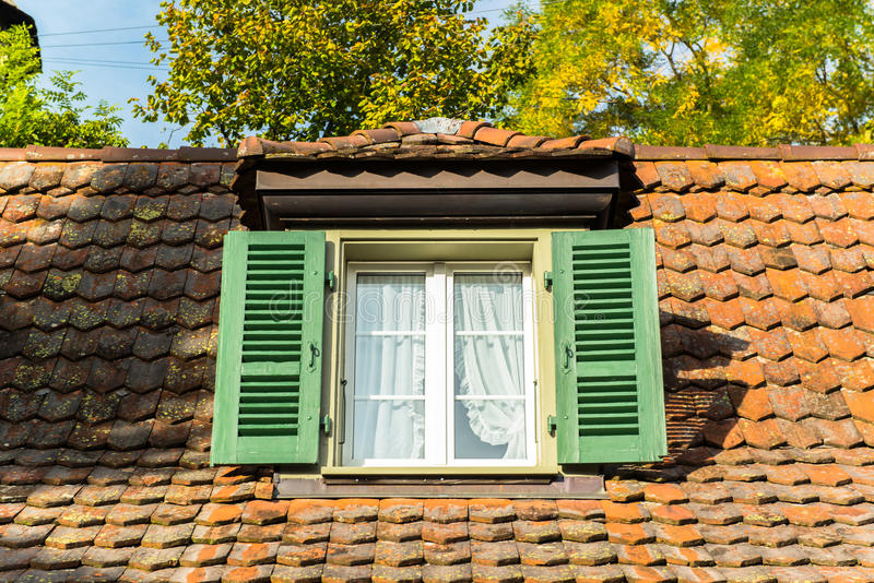 Window and garret roof. On the rooftop stock photos