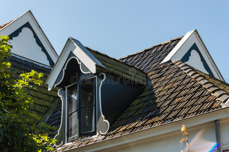 Window and garret roof. Traditional Dutch Window and Garret roof royalty free stock photography