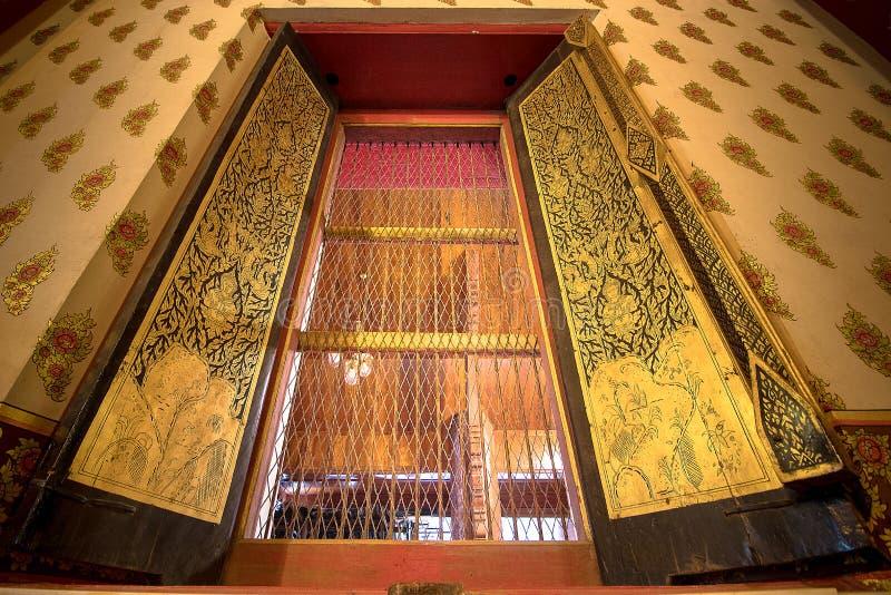 The window of Giant golden Buddha in Wat Phanan Choeng Temple in stock photo