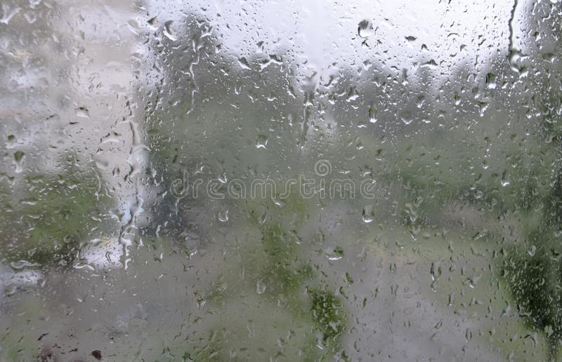 Window glass in raindrops, rain day, nature, texture stock photography