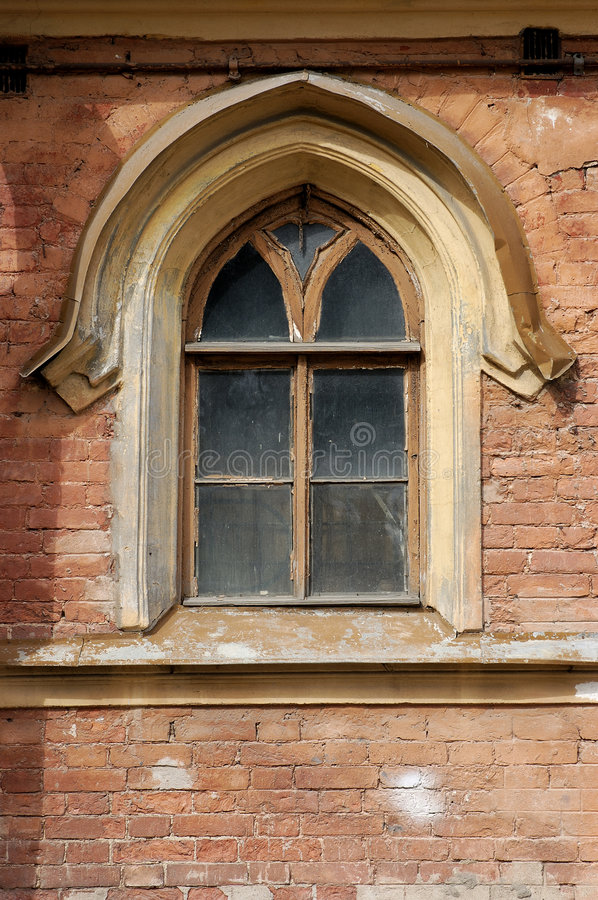 Window in Gothic style. Wall of the old house. A window in Gothic style stock photos