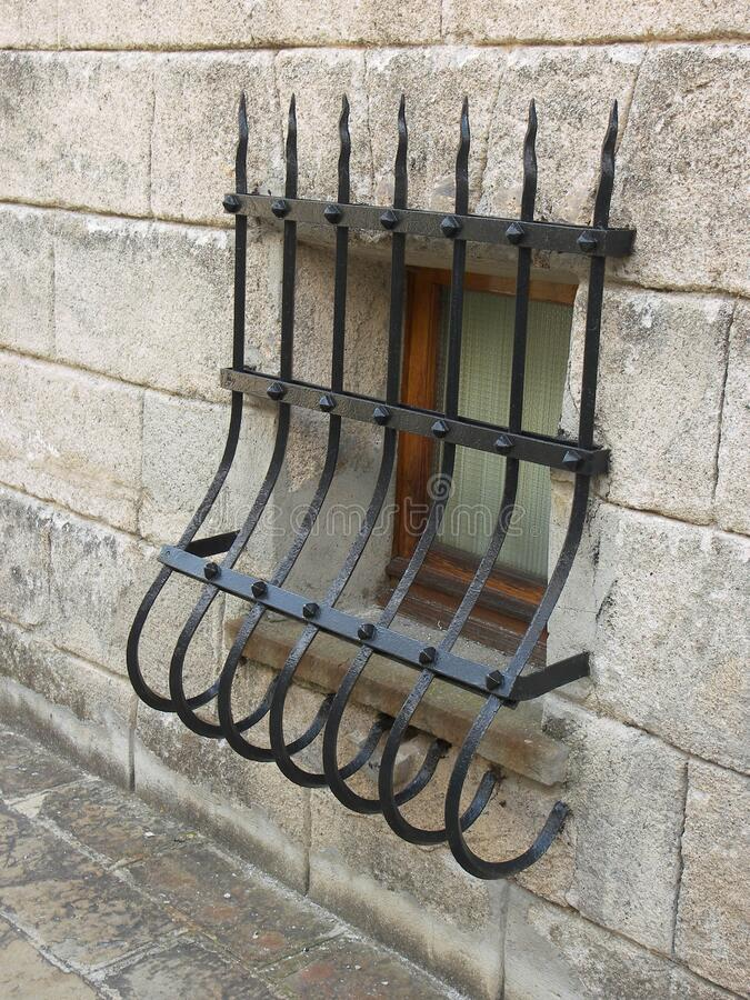 Window grate bars. Art creation related to grate featuring window grate bars. The artistic domain is window, architecture stock photography