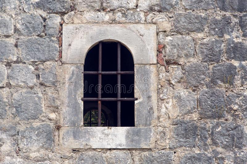 Window with grate in old building in Montenegro royalty free stock photo