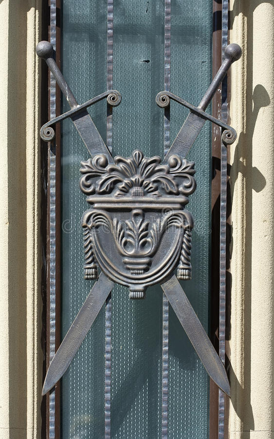 Window with heraldic details. Window with swords heraldic details royalty free stock image