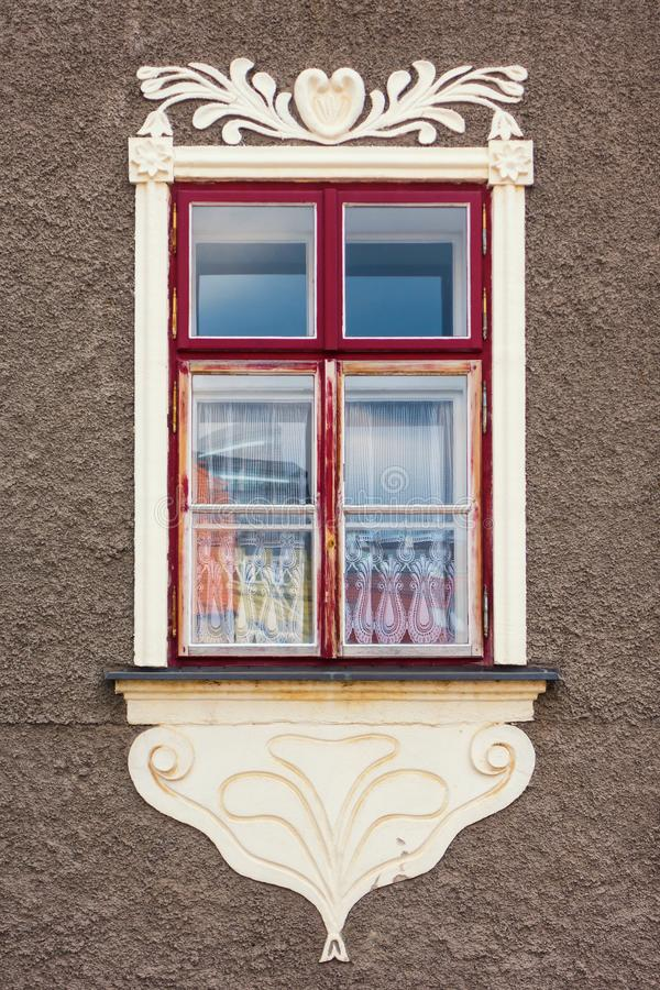 Window on a historic building decorated with sgraffito. Czech stock photography