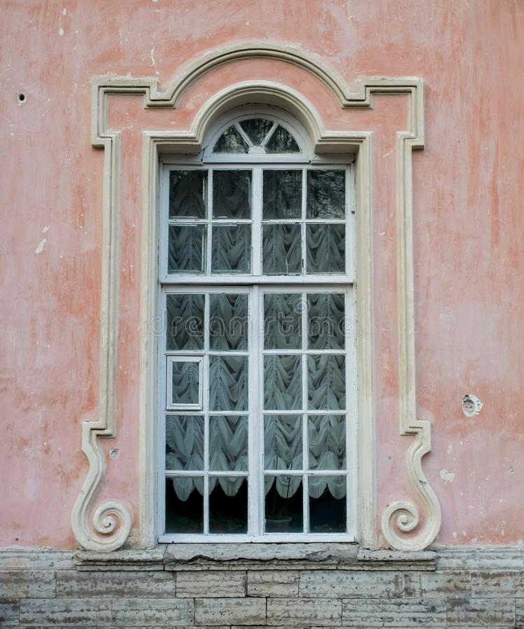 Window historical building pink wall texture palace. Outdoor stone detail stock photos