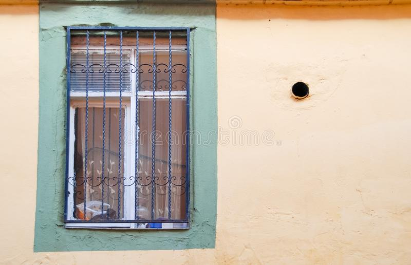Window and hole on facade of Old House. Window and hole in the facade of Old House royalty free stock photos