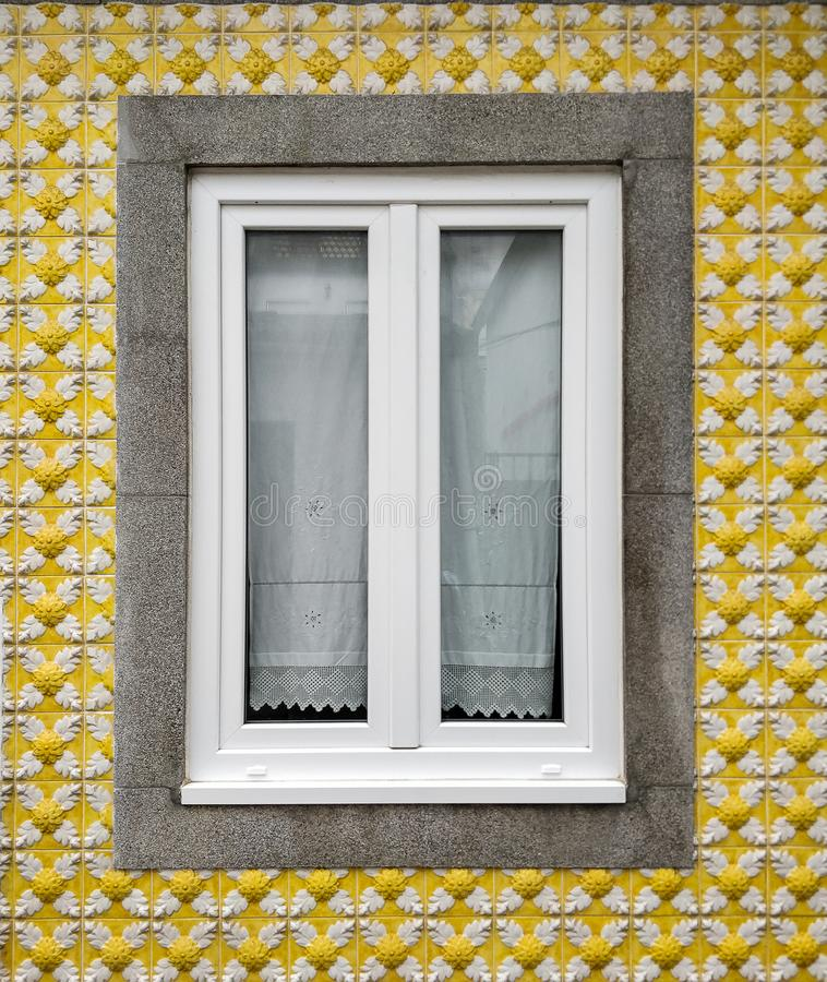 Window, home with yellow tile facade in the fishermen`s neighborhood in Aveiro, Portugal stock photography