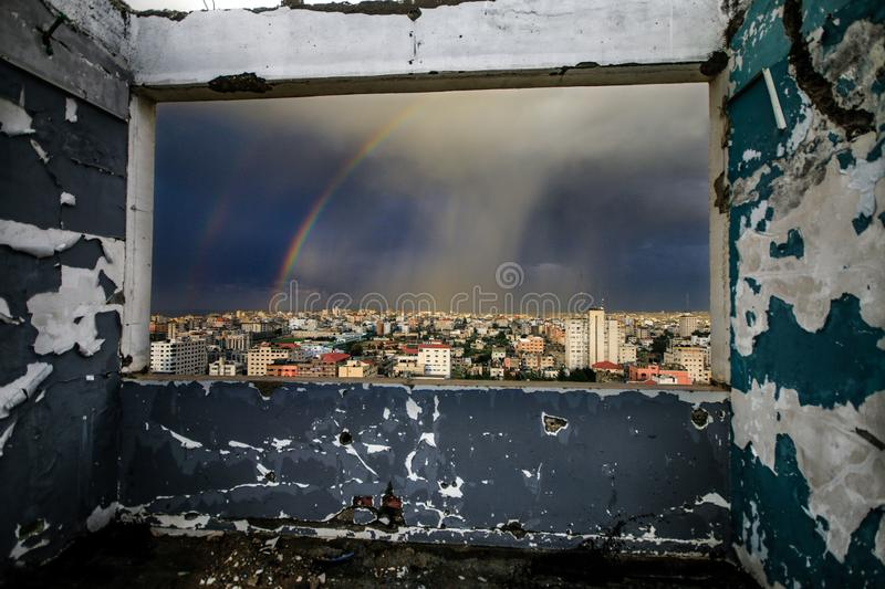 Window of hope city scene. See the Rainbow of broken window in a very beautiful day royalty free stock images