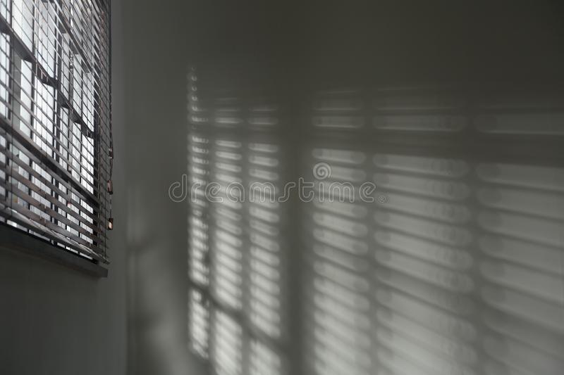 Window with horizontal blinds in room. Toned in black and white. Window with horizontal blinds in room, space for text. Toned in black and white royalty free stock photos