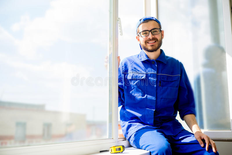 Window installation worker royalty free stock images