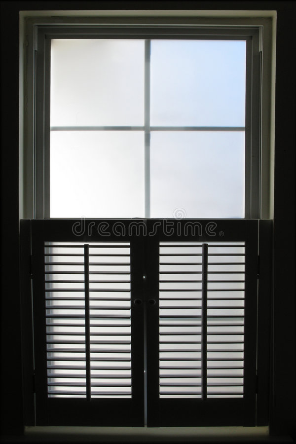 Window with Interior Shutters Viewed from Inside stock image