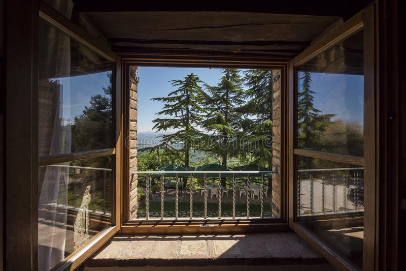 Window on large garden with trees stock images