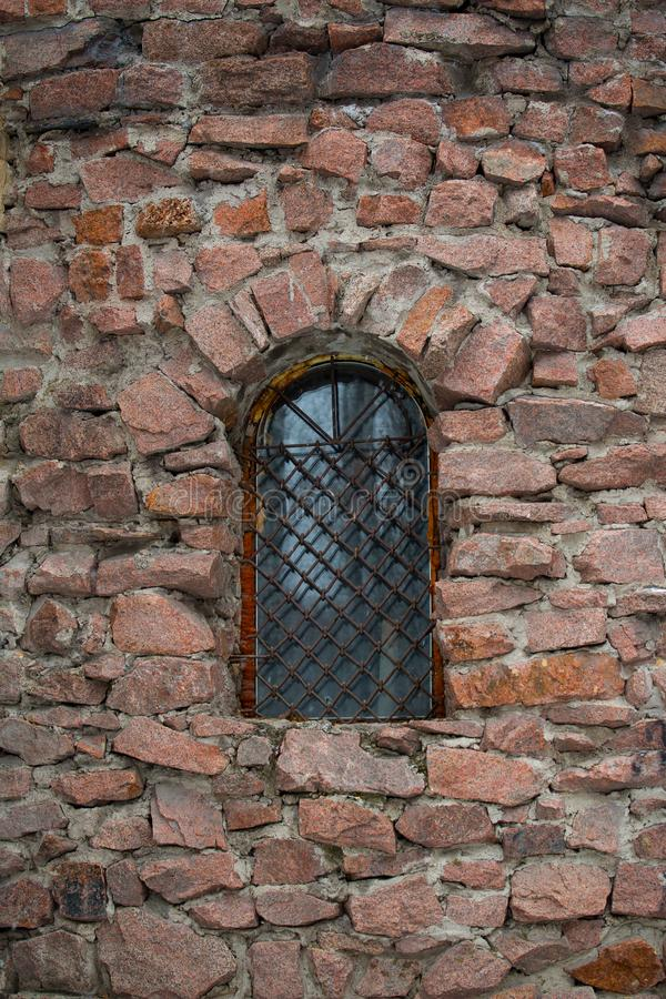 A window with a lattice in a stone tower royalty free stock photo