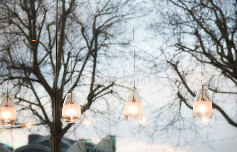 Window and lights. Modern lights in a coffee shop next to window looking out at London street royalty free stock photos