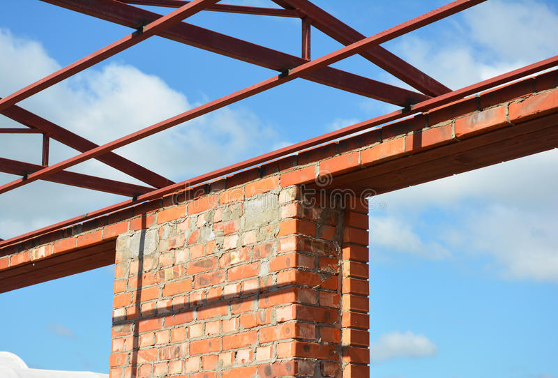 Window lintel construction. Steel roof trusses details with bricklaying frame windows construction. Steel Lintels. Window lintel construction. Steel roof stock image