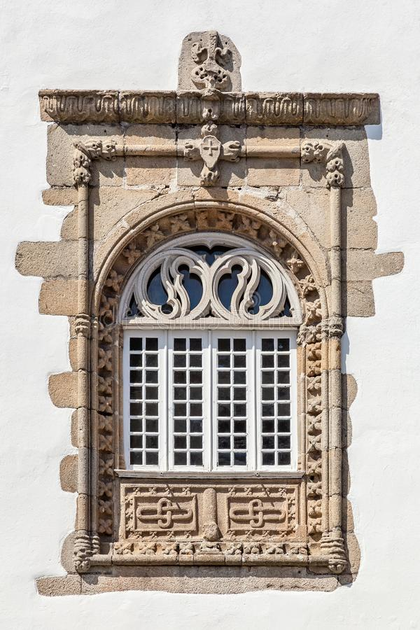Window in the Manuelino style Portuguese Gothic from the Coimbras House. Braga city, Portugal.  stock image