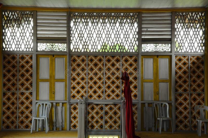 Window of Masjid Ihsaniah Iskandariah at Kuala Kangsar. KUALA KANGSAR PERAK, MALAYSIA – APRIL 2014: Ihsaniah Iskandariah Mosque a.k.a. Masjid Lama Kampung royalty free stock images