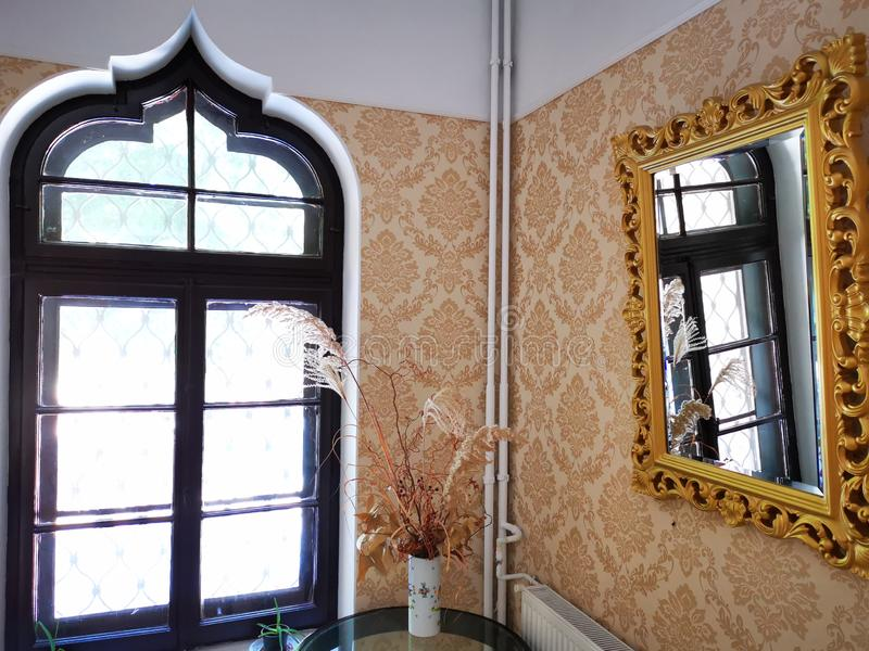 The window mirrored in the mirror. Corner with table royalty free stock images