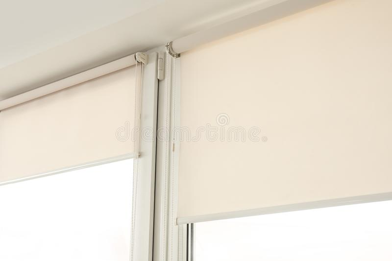 Window with modern roll blinds in room. Closeup stock photos