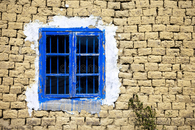 Window in mud wall. A wooden window of a mud house stock images