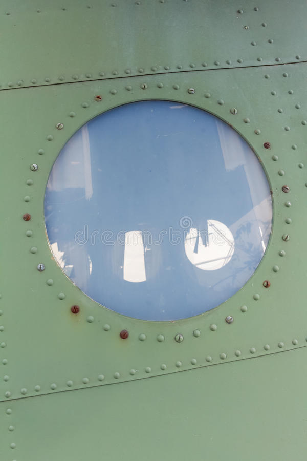 Window in old airplane, aluminum background detail of a military aircraft royalty free stock photos