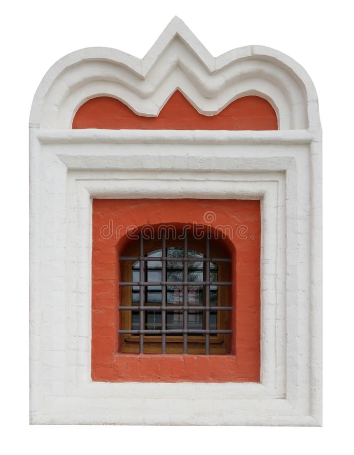 The window of the old medieval church is framed by a white plaster clype. stock image